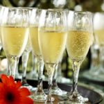 trays of champagne filled glasses for the toast at a wedding reception